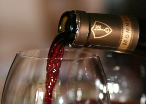 pouring, hopefully the best wine (photo from moreintelligentlife.com