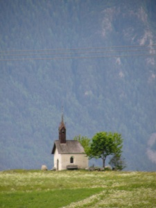 a church in the distance (near Brunico)